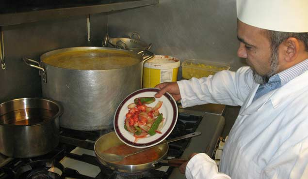 Balti Central's award winning chef seen cooking